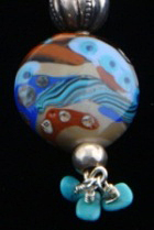 Kumihimo traditional kusari-tsunagi silk braid using 8 tama or bobbins, silver findings, amber, silver and turquoise beads. Flameworked Moretti glass focal bead.